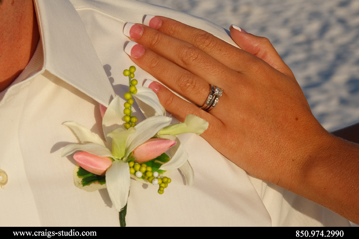 Close up of Kevin's flowers and Robyn's wedding rings